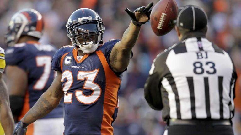Denver Broncos running back Willis McGahee (23) flips