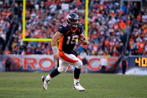 Tim Tebow #15 of the Denver Broncos run