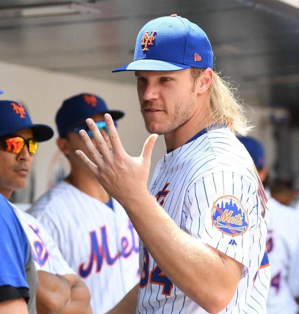 New York Mets pitcher Noah Syndergaard gestures in