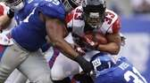 Atlanta Falcons running back Michael Turner is tackled