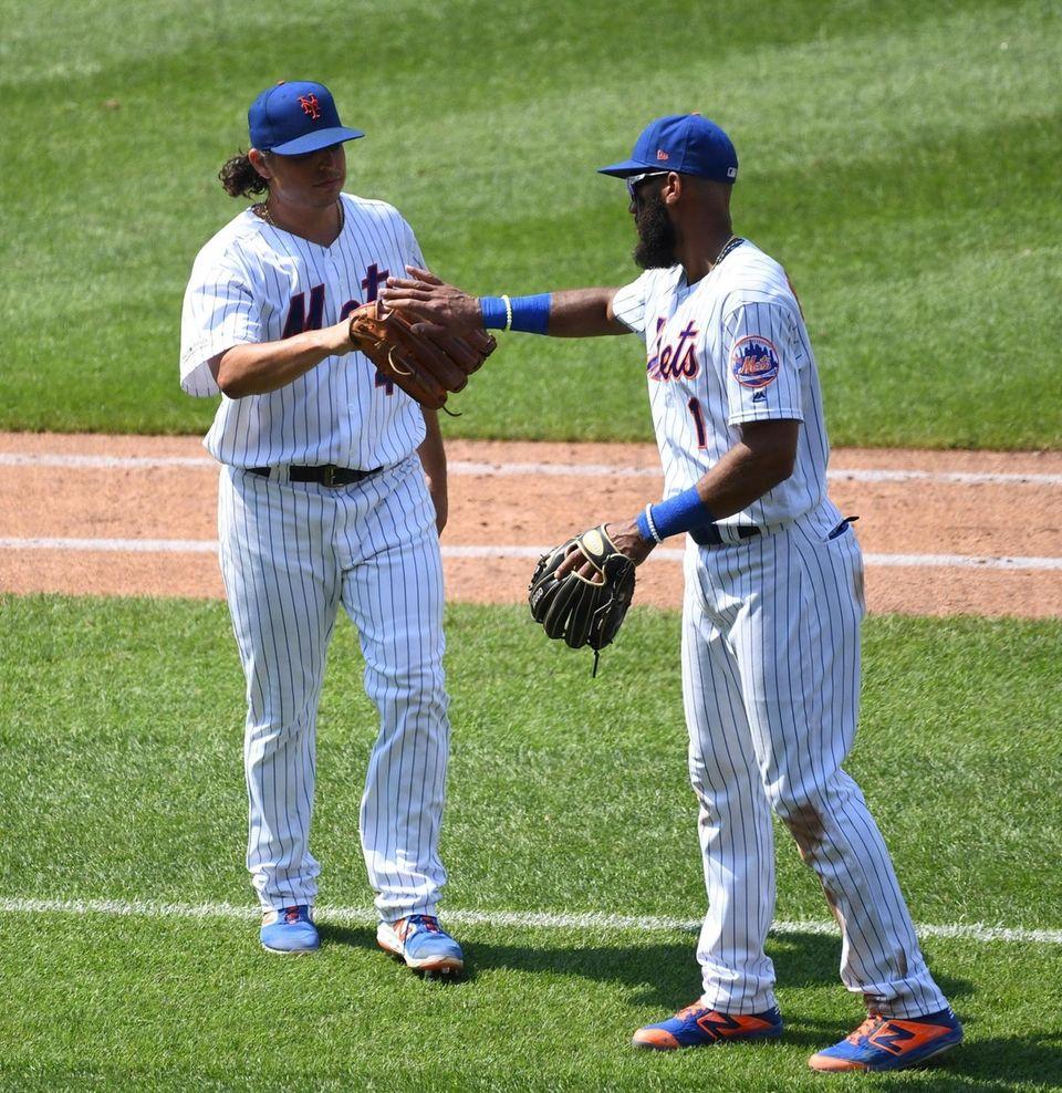 New York Mets starting pitcher Jason Vargasis greeted