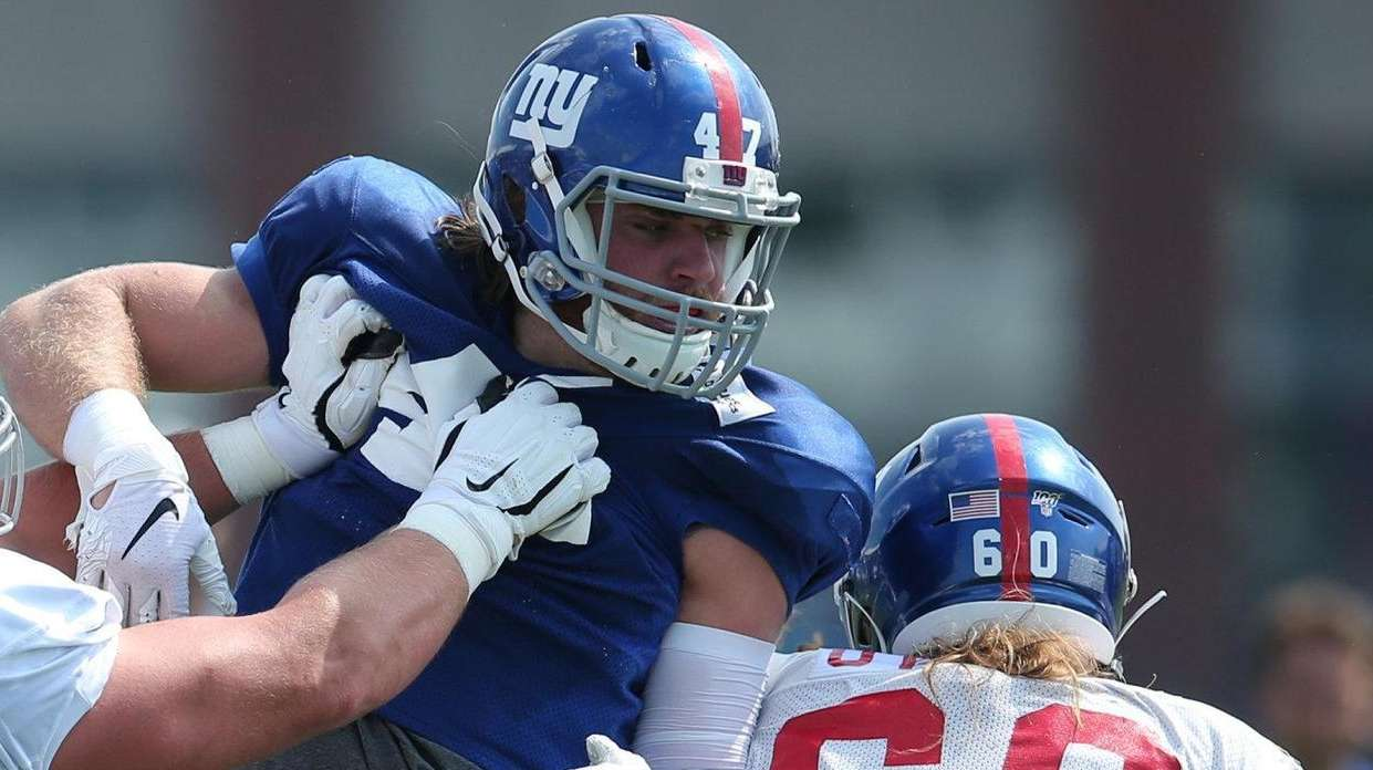 Giants offensive guard Austin Droogsma (66) and center