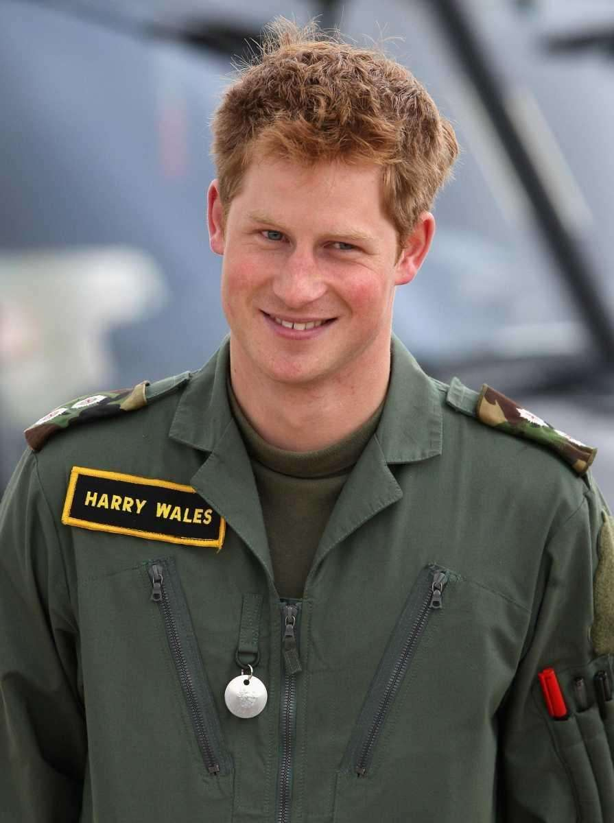 Prince Harry poses in front of a Griffin