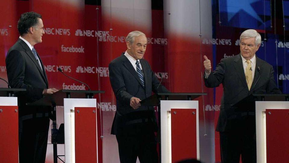 Former Massachusetts Gov. Mitt Romney, left, and former