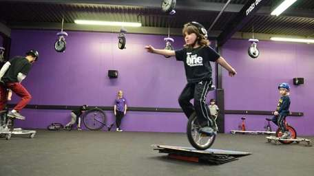 Ziggy Cohen, 5, practices riding his unicycle off