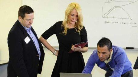 Peter Iuvara, right,of mindShift Technologies teaches Twitter strategies
