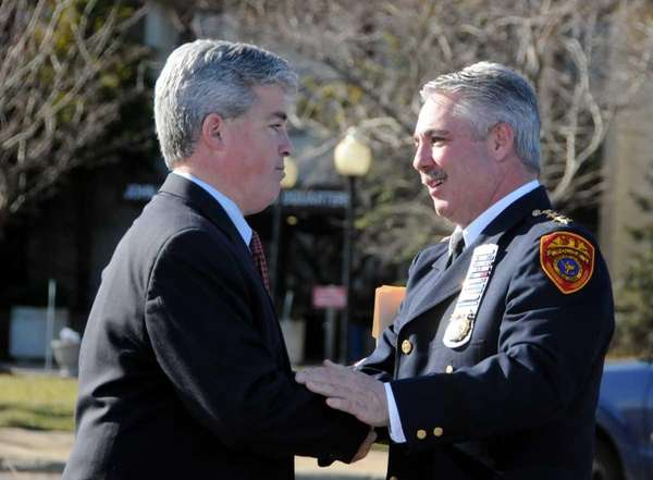 Suffolk County Executive, Steve Bellone, embraces Suffolk Police
