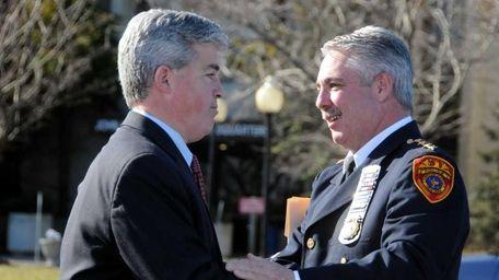 Suffolk County Executive, Steve Bellone, embraces Suffolk Police
