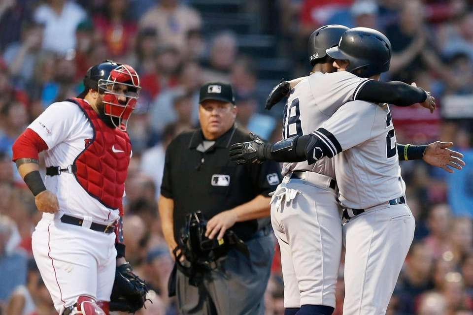 Yankees catcher Austin Romine, right, celebrates his two-run