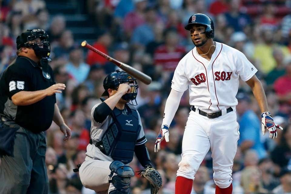 The Red Sox's Xander Bogaerts, right, reacts to
