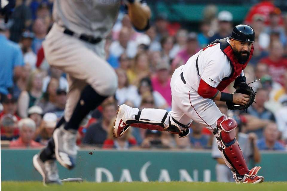 Red Sox catcher Sandy Leon, right, fields the