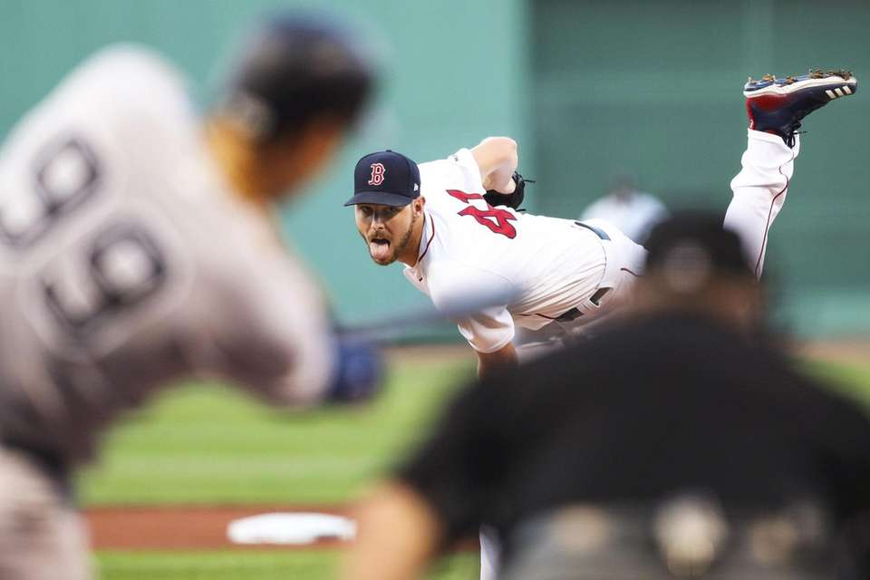 Red Sox pitcher Chris Sale delivers to Yankees
