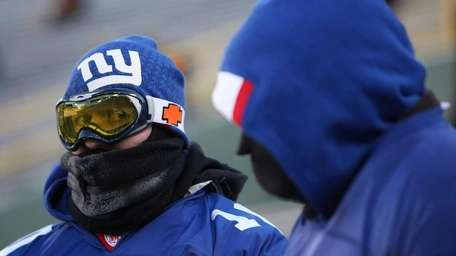 New York Giants fans sit bundled up as