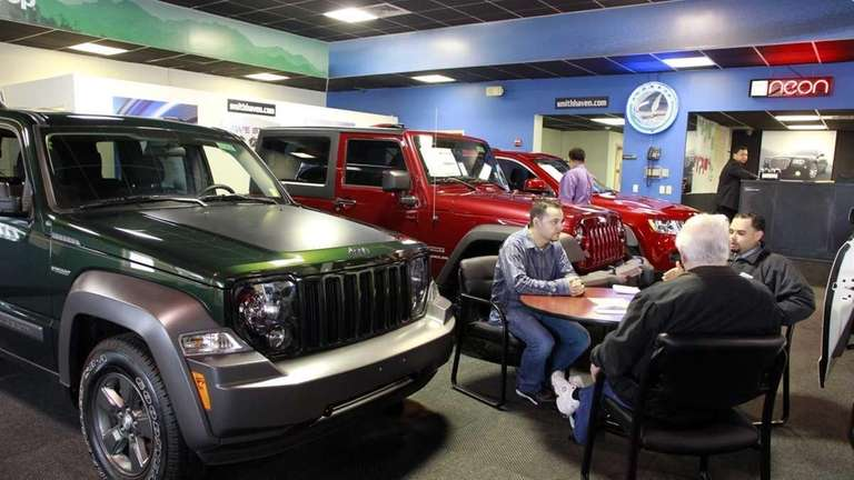 Customers look over some of the new Jeep