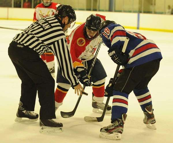 Connetquot/Sayville's Joseph Bizzaro, center, and Smithtown's Jonathan Gianchetta,
