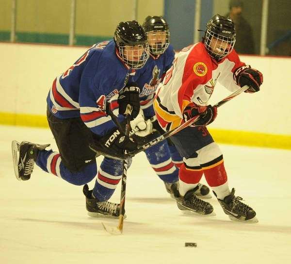 Connetquot/Sayville's Bryan Arroyo, right, defends against Smithtown's Brian