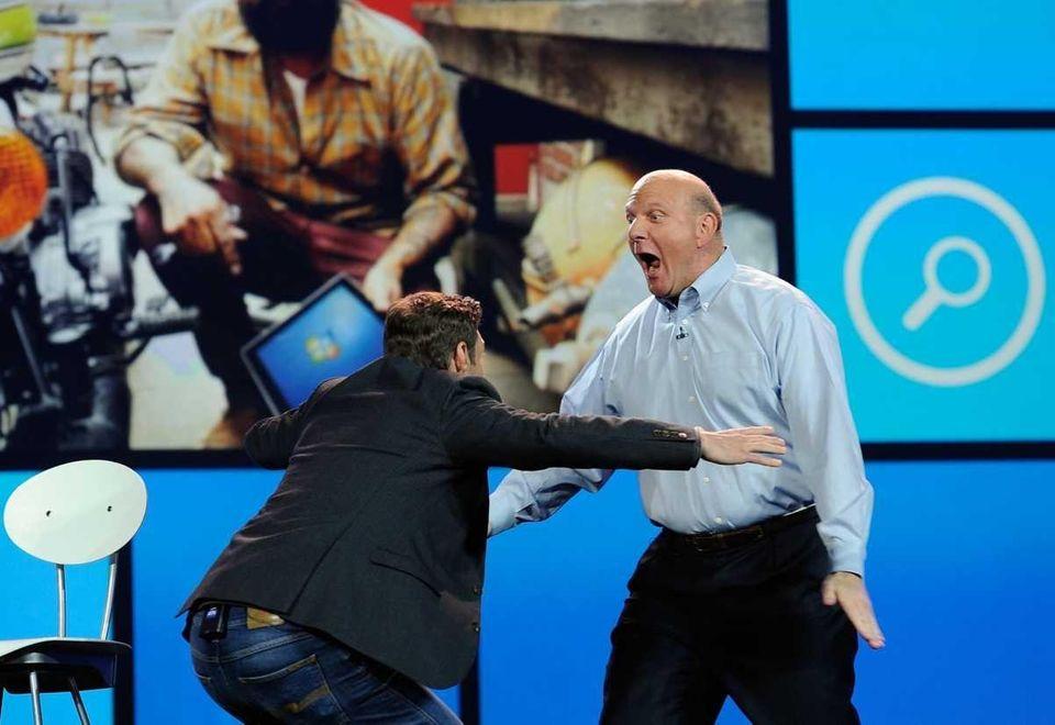 Host Ryan Seacrest greets Microsoft chief executive Steve