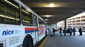 Commuters board a NICE bus in Mineola. (Jan.