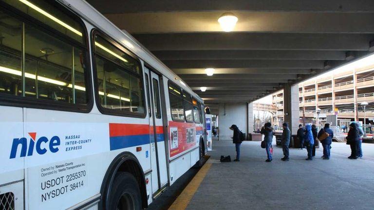 Commuters board a NICE bus in Mineola. (Jan.