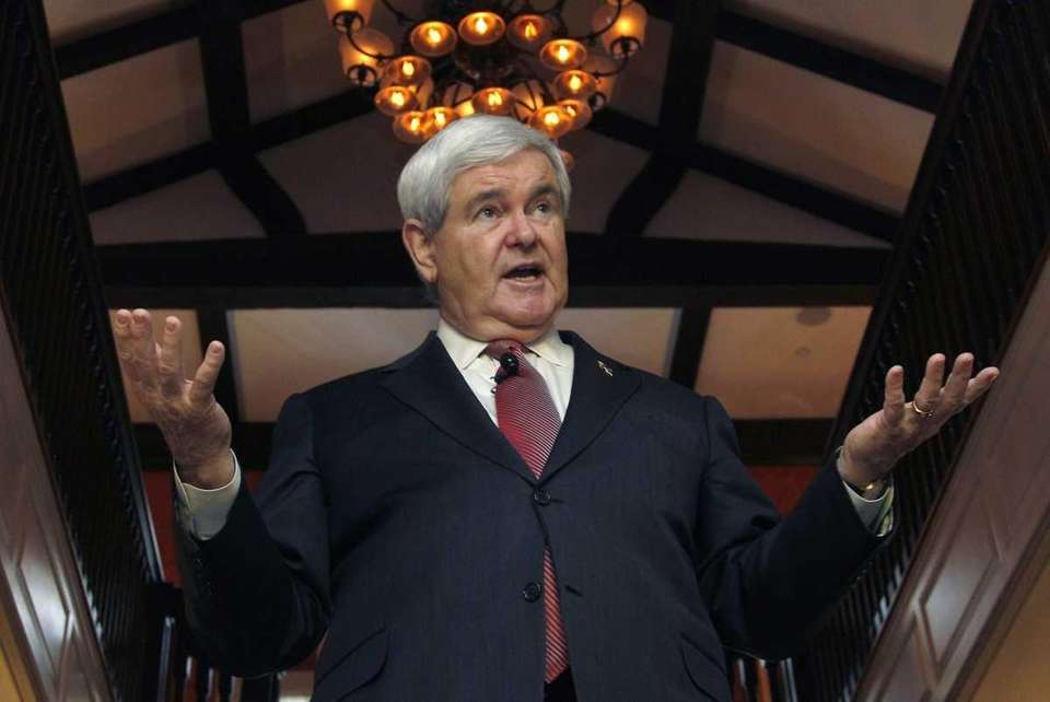 Republican presidential candidate Newt Gingrich gestures during a