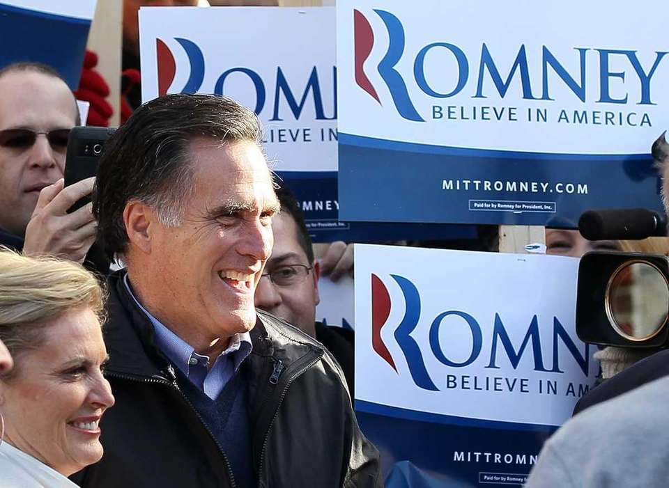 Republican presidential hopeful Mitt Romney greets supporters outside