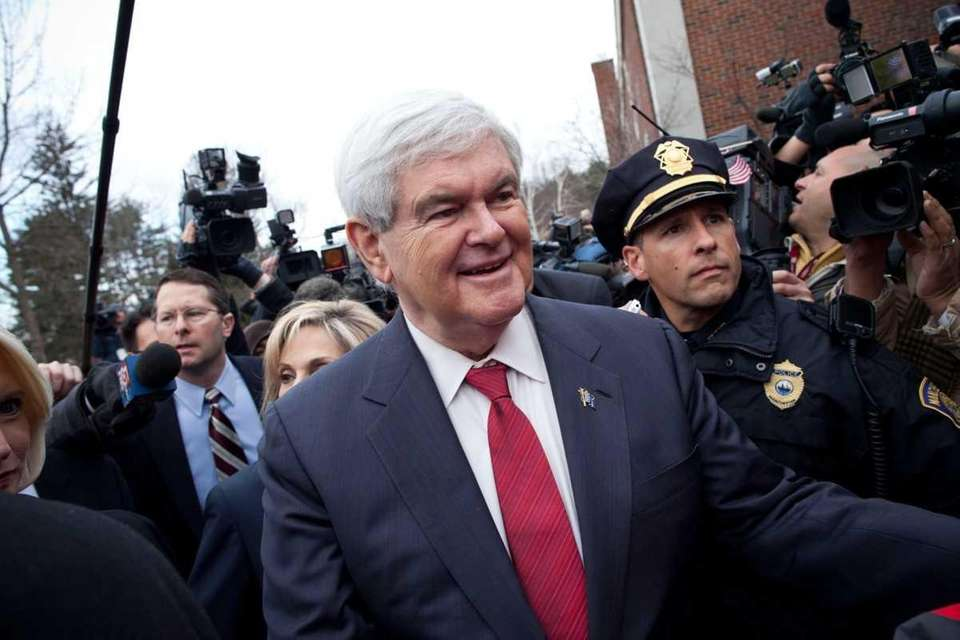 Republican presidential candidate Newt Gingrich greets people outside