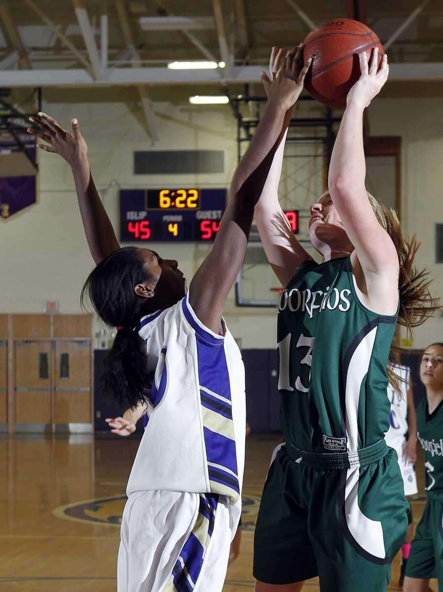 Harborfield's Amy Werbitsky is fouled under the basket