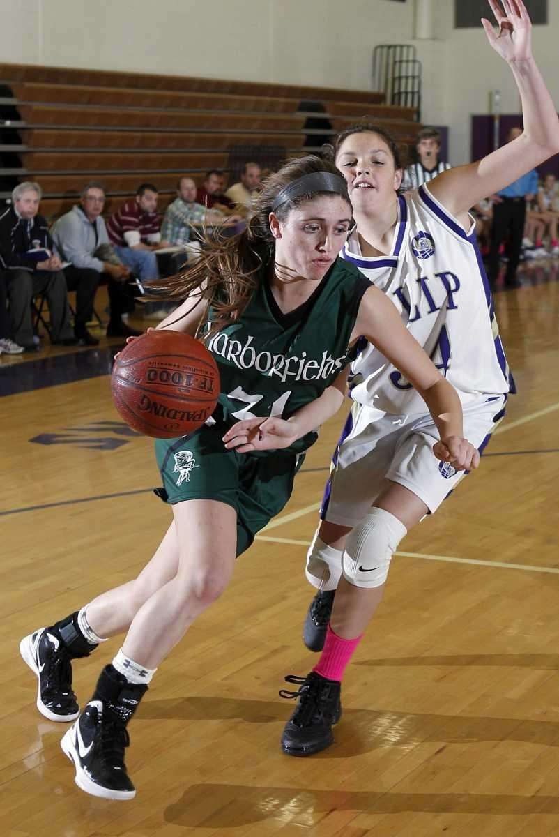 Harborfield's Kasey Stolba drives around Islip's Meghan Oberg