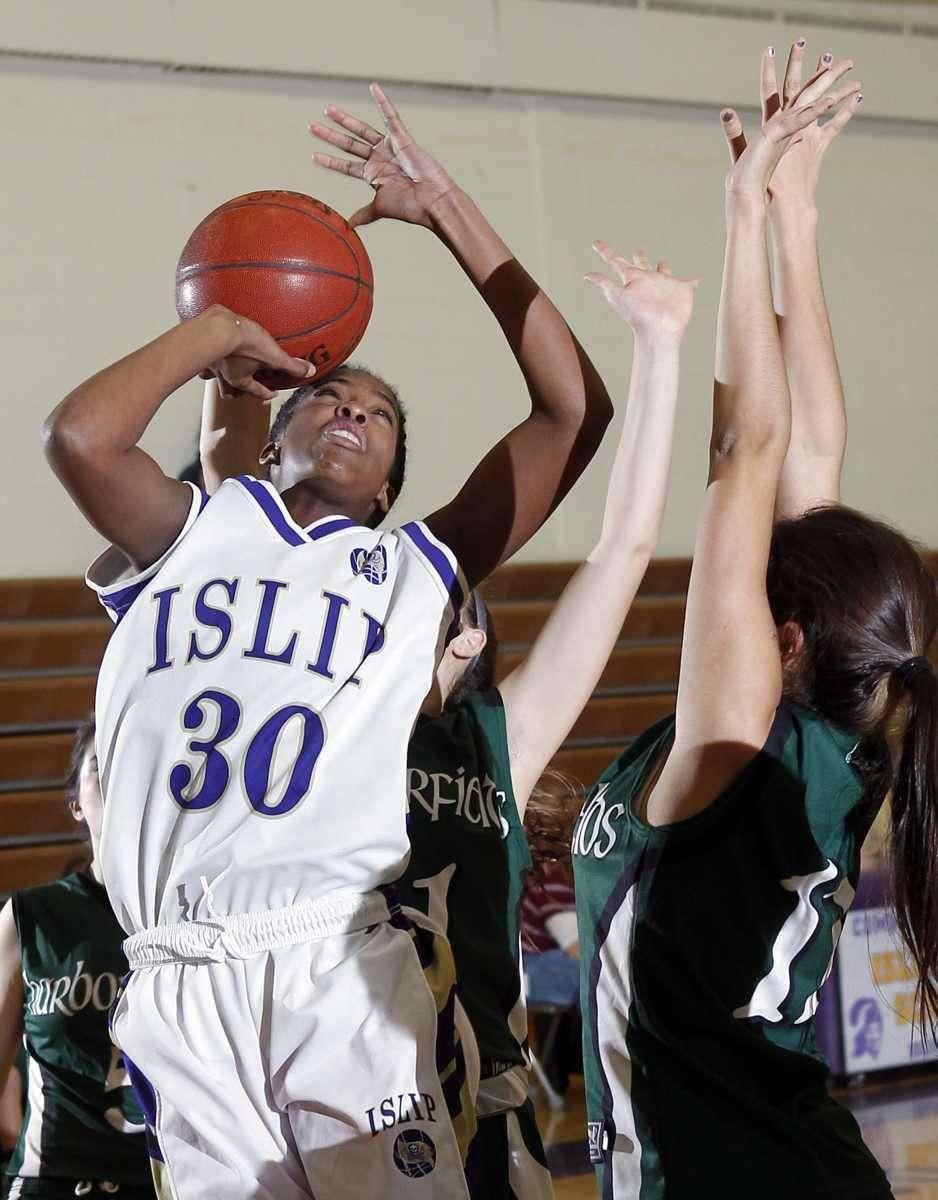 Islip's Italee Brown-Smikle is fouled from behind by
