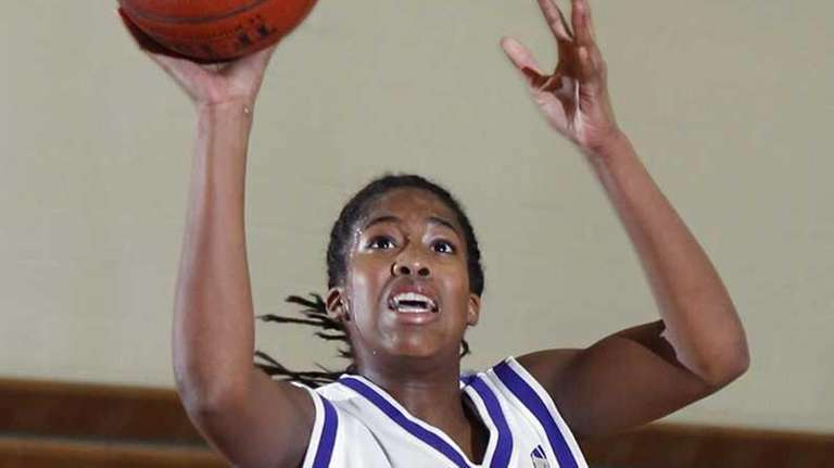 Islip's Italee Brown-Smikle gets off the jumper in