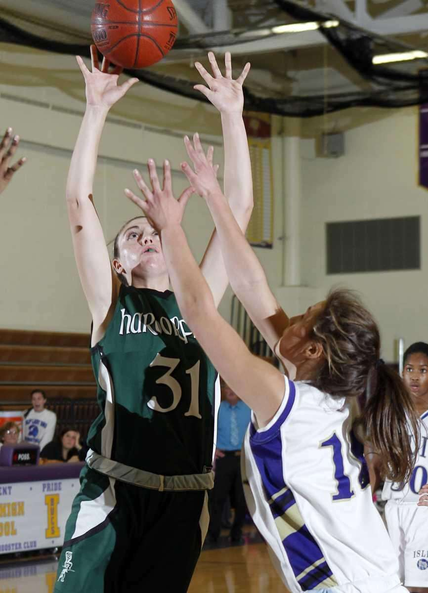 Harborfield's Kasey Stolba with the jumper over Islip's