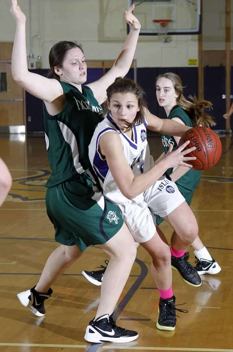 Islip's Vanessa Juengerkes drives into the paint around