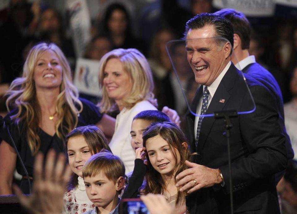 Republican presidential hopeful Mitt Romney celebrates with family