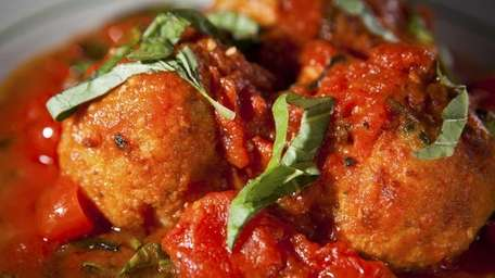 Lobster meatballs, slowly simmered in a San Marzano