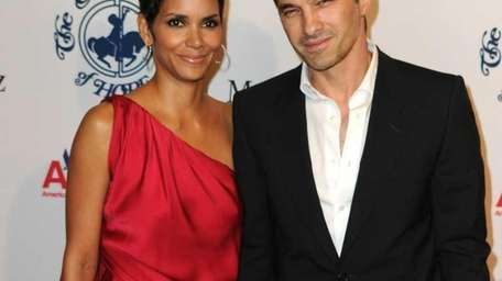 Actress Halle Berry and Olivier Martinez arrive at