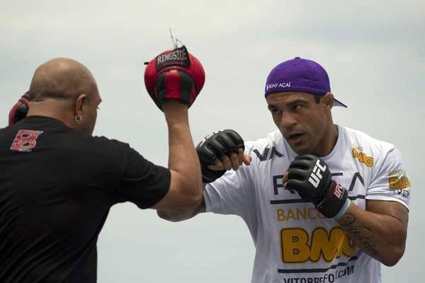 Vitor Belfort, of Brazil, right, trains during UFC