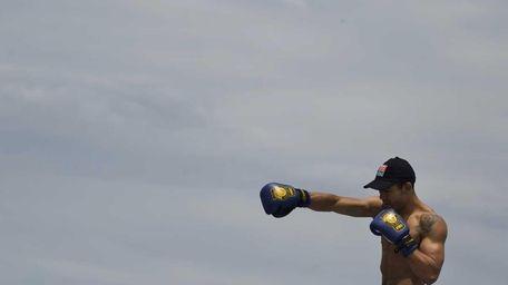 Jose Aldo, of Brazil, prepares to train during