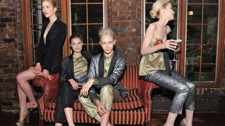 Models pose during the Stella McCartney Autumn 2012