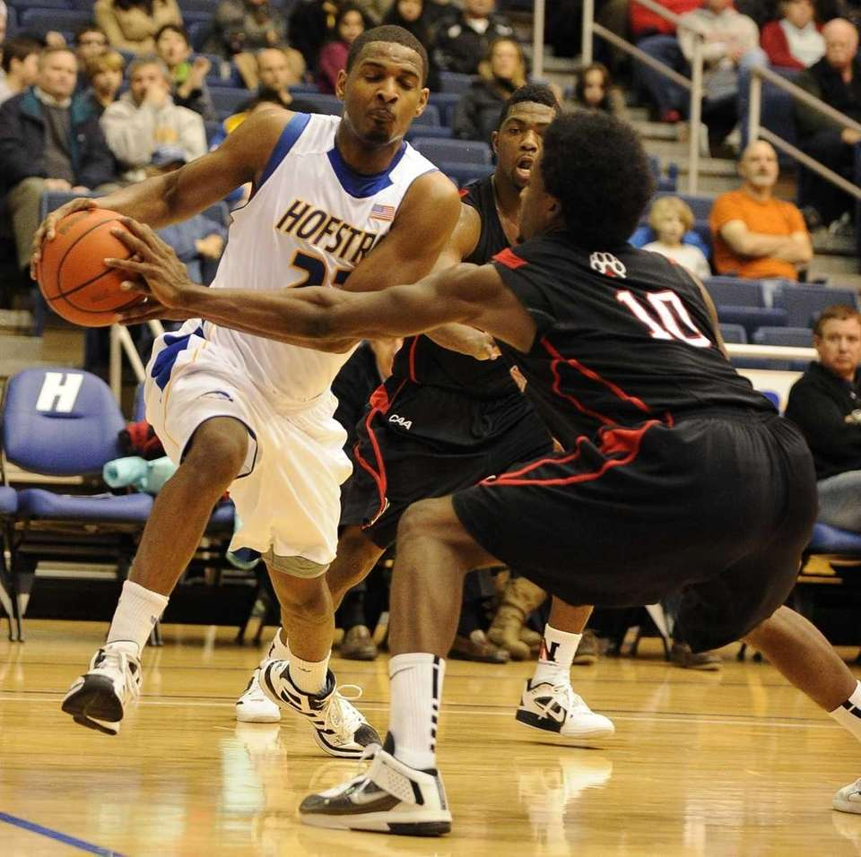 Hofstra guard Mike Moore drives the ball along