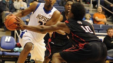 Hofstra guard Mike Moore drives the ball along