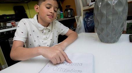 Pablo Herrera of Brentwood writes down Spanish words