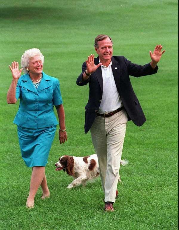 President George H.W. Bush and Mrs. Bush walk