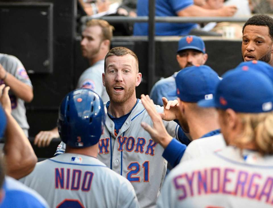New York Mets' Todd Frazier (21) is greeted