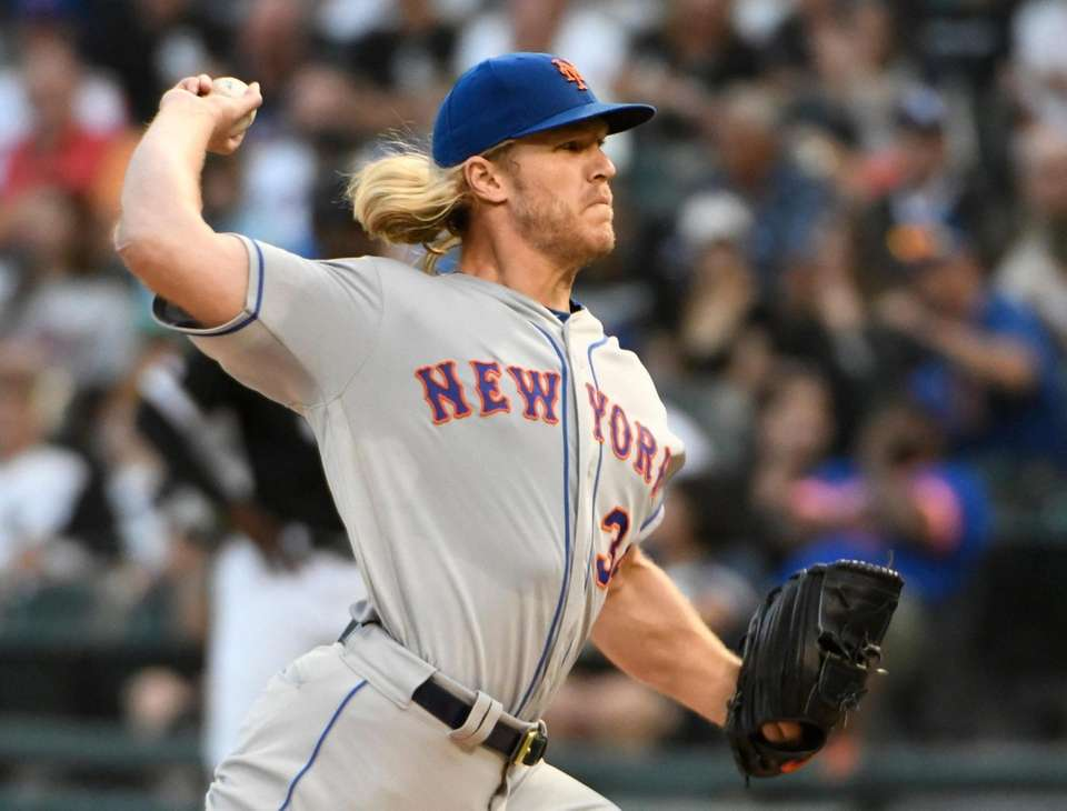 Mets starting pitcher Noah Syndergaard throws to a