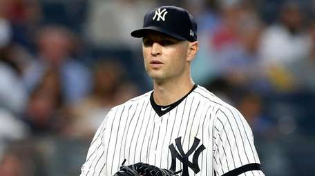 J.A. Happ #34 of the Yankees looks on