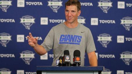 New York Giants quarterback Eli Manning (10) speaks