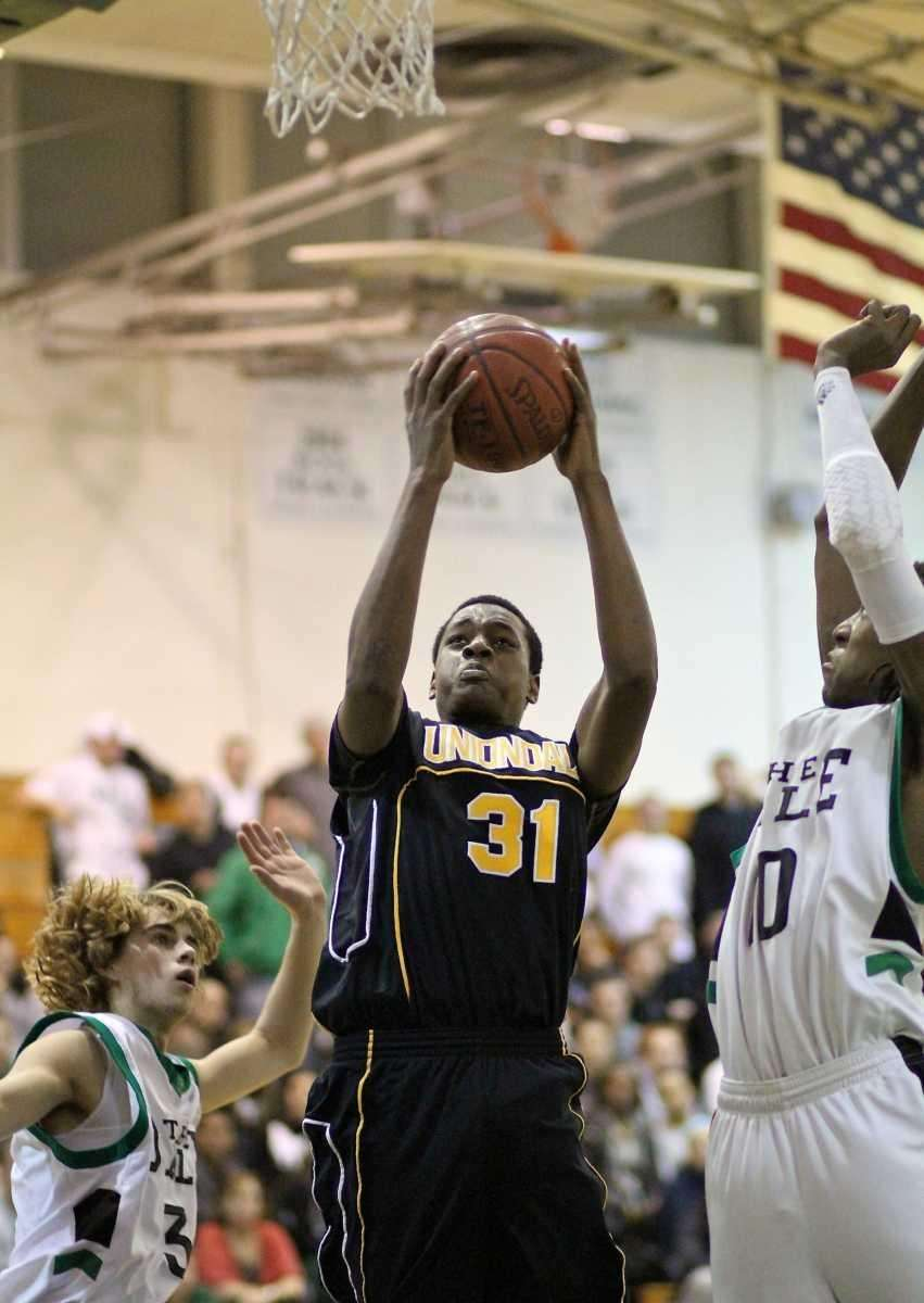 Uniondale F Terrance Brown #31, puts up the