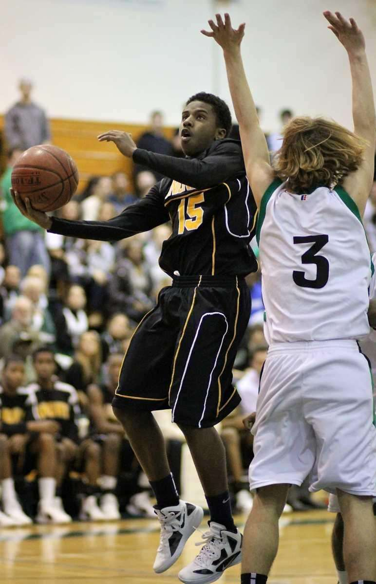 Uniondale's Shaquille Mosley blows by Farmingdale guard Jack