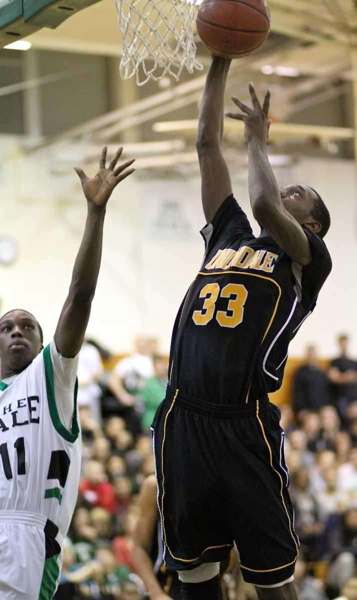 Uniondale G Kenny Woodward #33, puts up a