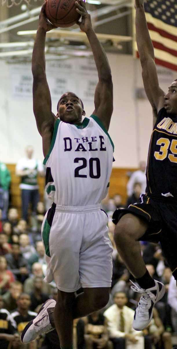 Farmingdale F Kevin Petit-Frere #20 goes up for